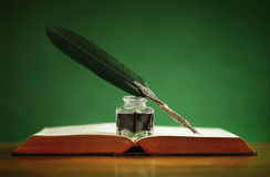 quill-pen-inkwell-old-book-resting-green-background-concept-literature-writing-author-history-40432895