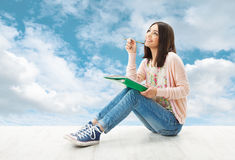 woman-thinking-inspiration-write-idea-young-girl-teenager-sitting-over-blue-sky-background-39057434